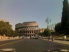 Via dei Fori Imperiali con il Colosseo, Roma. The location used in the book is not in back of the picture, it is the street.