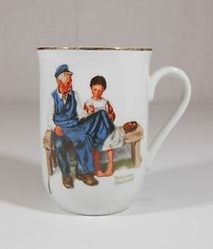 $12.50 2014 NORMAN ROCKWELL MUSEUM  THE LIGHTHOUSE KEEPERS DAUGHTER  Coffee Mug Cup Gold Rimmed Edition 4 1/8 . No chips, cracks or crazing. The gold rim on the edging shows normal usage due to age. Shelf 3. Vis