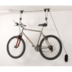 $14.36? Awesome. pulley bike rack - could use these along the roofline on the side of our house