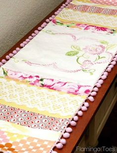 Take linen scraps and make a cute cottage style table runner, place mats and napkins.