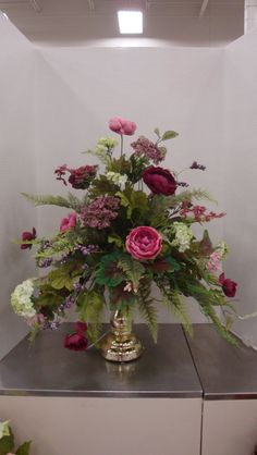 A mixed arrangement of ranunculus, hydrangeas and heather, designed by Christine Crowley for Michaels in Willowbrook, IL (2016)