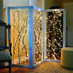 Branches lit up to create a whimsical room screen.  Great idea for weddings too!