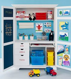 A designated play space keeps kids crafts and toys in one main location. Low drawers and bin-lined shelves store toys at kid-level, while the top shelf is reserved for board games. A built-in desktop provides plenty of creative space for projects or homework. The chalkboard and bulletin boards inside the doors are perfect for doodling or displaying artwork. organising-storage
