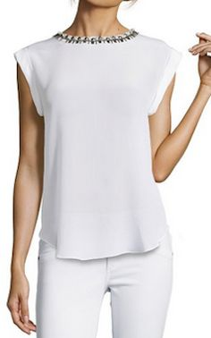 White sleeveless blouse with embellished neck