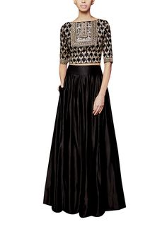 A stylish and gorgeous sharara by Anita Dongre when you want to look fabulous wearing something with an ethnic touch. The silk crop top is elaborately embroidered in gota patti and dori work and is styled over a silk sharara. #anitadongre #lehenga #indian #designer