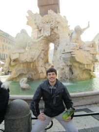 Brent sits at the Four Rivers fountain in Rome