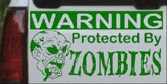 6in X 11.1in Dark Green -- Protected By Zombies Funny Car Window Wall Laptop Decal Sticker @ niftywarehouse.com #NiftyWarehouse #Zombie #Horror #Zombies #Halloween