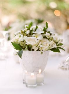 Our table in Bali lined with white floral centerpieces & candles.  Design by Lisa Vorce and Mindy Rice.  Photos by Aaron Delesie.