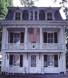 """""""Older buildings were often renovated to include trendy and practical mansard roofs. For this reason, Second Empire homes in the United States are often composites of Italianate, Gothic Revival, and other styles."""" Older house with added mansard roof."""