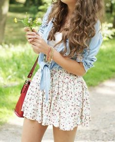 White flower skirt and jean tied shirt in combination with red handbag create amazing summer look. Best outfit ideas 2015.