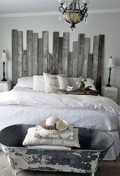 A vintage cowboy tub at the end of the bed provides storage for extra pillows and quilts  | vintage home decor ideas | | vintage home decor ideas diy | | vintage home decor ideas | https://steeltablelegs.com