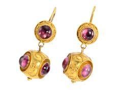 Etruscan Revival Amethyst Earrings - Fashioned out of 15k yellow gold, set with amethyst cabochons. Flat backed disc surmounts with central amethyst ornamented with twistd wire work in the Etruscan manner. Larger ball drops of yellow gold each appointed with 3 cabochons placed in bezels with corded rope per meters. Circa 1870