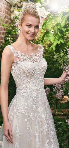 """Dress of the Week: """"Alexis"""" from the #RebeccaIngram collection by @maggiesottero . A flirty A-line gown with distinctive crosshatch motifs embellished with Swarovski crystals, delicate beading, and sequins. Exquisite! ///  #dressoftheweek #gownoftheweek #bridal #wedding #weddingdress #weddinggown #bridalgown #dreamgown #dreamdress #engaged #inspiration #bridalinspiration #bride #weddinginspiration #maggiesottero #weddingdresses #romantic #lace"""