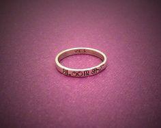 Metal stamped sterling silver ring.  www.facebook.com/AmbersWhimsy