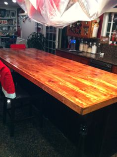 DIY wood countertop for kitchen island. I used $10 10 foot long boards (around 5) for my countertop. Great for big parties and entertaining.