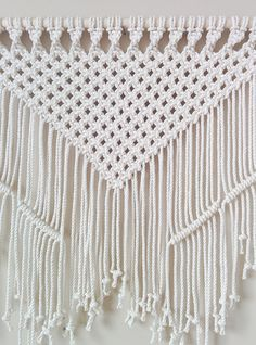 Classic macrame is elevated to modern art with this stylish wall hanging. Meticulously handcrafted to perfection with 100% cotton rope sourced locally within On