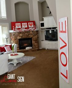 Make this giant LOVE sign for under $10!! Perfect for Valentine's Day! -- Tatertots and Jello #DIY #Valentines