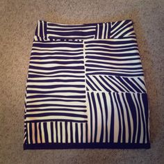 Ann Taylor midi/pencil skirt Dark brown and white pattern midi skirt. Like new! Has zipper on the side . Size 2 / small. Soft lining on the inside.  Ann Taylor Skirts Midi