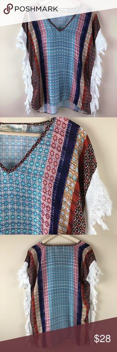 """=WANDERLUJO=FRINGE BLOUSE PONCHO TOP S Adorable festival top. V neck. Poly lightweight vibrant print. Cotton white fringe along sides and arm holes. Fits like a poncho is box cut but has arm holes for sleeves. Fits generous.  Pit to pit 22"""" length 28"""" V  Boho,hippie,gypsy,beach,spring,summer wanderlujo Tops Blouses"""