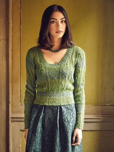 Hayling - Knit this ladies scoop neck sweater from Rowan Knitting & Crochet Magazine 58, a design by Martin Storey using our exquisite self striping yarn Alpaca Colour (alpaca and cotton.) With a variety of lovely cable patterns, some with bobbles in the centre, this knitting pattern is suitable for the more experienced knitter.