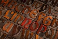 alphabet abstract - vintage wooden letterpress printing blocks (Abbey typeface)   with patina from color inks Stock Photo