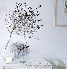 Beautiful Fall decoration.Combining Autumn treasures from nature with big glass bottles creates simple and elegant seasonal decor. http://www.songbirdblog.com
