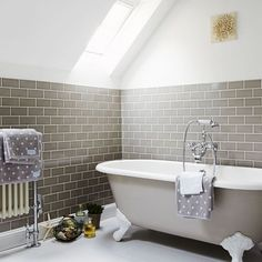 (Tile style and Color, Attic bathroom This beautiful family bathroom has striking grey wall tiles that stop where the attic ceiling begins to slope upwards. The roll-top bath is painted in the same soft grey, with everything else in simple white. Neutral Bathrooms Designs, Grey Bathrooms, Bathroom Design Small, Beautiful Bathrooms, White Bathroom, Bathroom Designs, Lavender Bathroom, Country Bathrooms, Feminine Bathroom