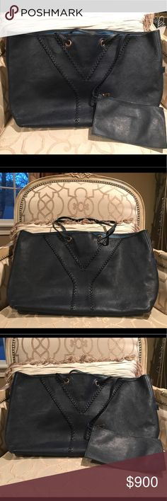 100% Authentic YSL Reversible Tote with Pouch! 100% Authentic YSL Reversible Tote with Pouch!  Amazing tote reversible in navy and royal blue. Pouch included!  From my own personal collection. I never sell fakes!  Check out my other listing! Saint Laurent Bags Totes