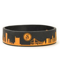 Show off your love for the City by the Bay with a Giants inspired orange San Francisco skyline graphic on a wide black silicone band.
