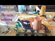 How to use acrylic paints for resin painting by Ellen Anderson for Resin Obsession - YouTube To be honest, I didn't think I'd like the outcome when I saw her color choices, etc... But, her finished painting is gorgeous! I've never heard of this technique before. But, I'm going to give it a try!