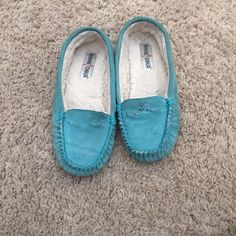 Teal Minnetonka slippers These comfortable slippers are slightly worn, but still have plenty of life left! Minnetonka Shoes Slippers