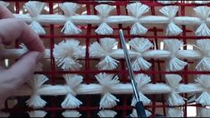 The best way to separate your wool for a pom pom blanket made all in the same color. It's difficult to cut out the pom poms from a base that is exactly the s...