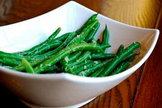 "This is one of my favorite sides to make, it pretty much goes with anything you want to eat. For one, I just love green beans – but when you add butter, garlic and parmesan it makes it irresistible. These garlic parmesan green beans are seriously tasty, they'll leave your plate just as fast as they touch it! I like the crunchy texture, so I don't fully cook my green beans when I'm steaming them. You might be asking ""How do I choose my green beans at the store?"" Easy! Take your time to pick…"