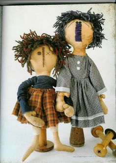 Two raggedy primitive dolls