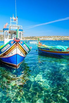 Luzzus - colourful traditional Maltese fishing boats.