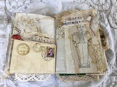 This gorgeous heirloom Christmas journal is a one of a kind beauty handmade from an old book cover that Iv altered The cover features a vintage advertisement that Iv added a rusty bookplate, silk flowers, pom trim, silk sari and a variety of other elements. The 2017 is stamped on a piece of paper that can be taken out. Inside you will find two hand sewn signatures - 60 pages - mostly blank papers with some tracing and scrapbook papers. Most of the pages have been embellished and some Iv…