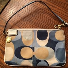 COACH wristlet. Multi use wristlet..inside pocket.  Good condition..multi color fabric Coach Bags Clutches & Wristlets