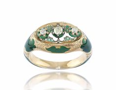 AN ANTIQUE DIAMOND, EMERALD AND ENAMEL BANGLE -  The hollow tapered gold band engraved with foliate motifs and applied with green enamel, to the three central cushion-shaped diamond collets, each on a green enameled ring base, enhanced by emerald-set leaves, mid-19th Century