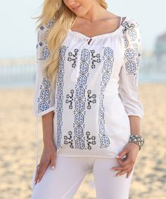 This Ananda's Collection White & Blue Embroidered Off-Shoulder Tunic by Ananda's Collection is perfect! #zulilyfinds