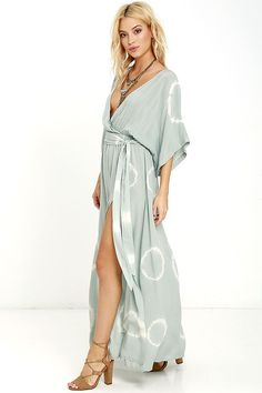 Lulus Exclusive! The sunshine cant help but follow whoever has the Long Live Love Sage Green Tie-Dye Maxi Dress! Cream and sage green tie-dyed rayon covers wide short sleeves, and a surplice bodice with modesty snap. Elasticized waist (and tying sash) rest above the maxi skirt with side slit. As Seen On Halley of @the_salty_blonde!