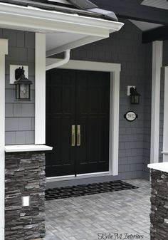 LOVE the black painted double front door. Painted shingles are Chelsea Gray by … LOVE the black painted double front door. Painted shingles are Chelsea Gray by Benjamin Moore. White trim and dark charcoal ledgestone. Chelsea Gray, House Paint Exterior, Home Exterior Colors, Siding Colors For Houses, Stone On House Exterior, Gray Exterior Houses, Stone Front House, Vinyl Siding Colors, Exterior Paint Colors For House With Stone
