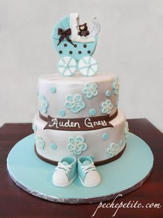 Blue and silver baby carriage shower cake with brown accents
