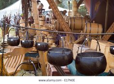Tewkesbury Medieval Festival, July 2013: iron cauldrons, wooden casks and other hand crafted historical wares on a market stall Stock Photo