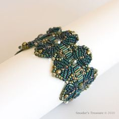 Wide Feathers Beaded Bracelet in Dark Blue and by SmadarsTreasure, $89.00