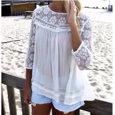 Lace Detailed Top white or mocha Gorgeous essential top with lace sleeve and dainty details! So pretty and perfect over jeans! Size S M L. runs true to women's sizing! Small mocha sold out Tops Blouses