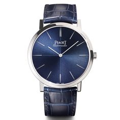 Piaget's ultra thin Altiplano 60th Anniversary Collection 43mm watch is set in white gold with a sunburst blue dial and blue alligator strap. Discover the luxury fashion watch trend for men and women that sees the watch faces and dials turning blue: http://www.thejewelleryeditor.com/watches/article/blue-dials-trend-in-watchmaking/ #watches