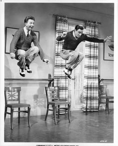 Gene Kelly: Donald O'Connor and Gene Kelly jump off of chairs in a scene from Singin' In The Rain. Kelly brought athleticism and a laid-back masculinity to his roles and choreography. (Photo by Metro-Goldwyn-Mayer/Getty Images)