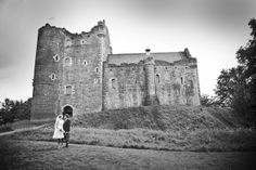 Fab pic - bride and groom outside Doune Castle, by Jen Owens Images