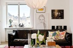 Love the feminine touches with this masculine black leather sofa