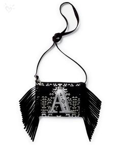 With metallic Aztec print, shimmering initials and lots of fringe, this crossbody will make a statement!
